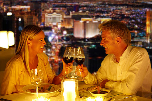 Picture of couple enjoying dinner at top Las Vegas restaurant with view of the Strip