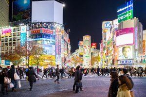TOKYO - DECEMBER 10: Pedestrians cross at Shibuya Crossing in Tokyo, Japan, one of the world's busiest crosswalks