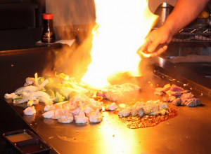 teppan grill food preparation with flaming grill
