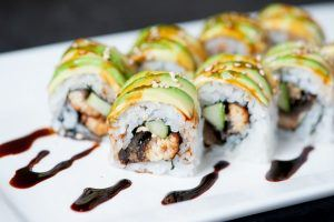 Osaka sushi roll on plate avocado