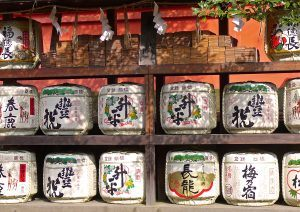 Japanese sake barrels stacked in a Shinto shrine.