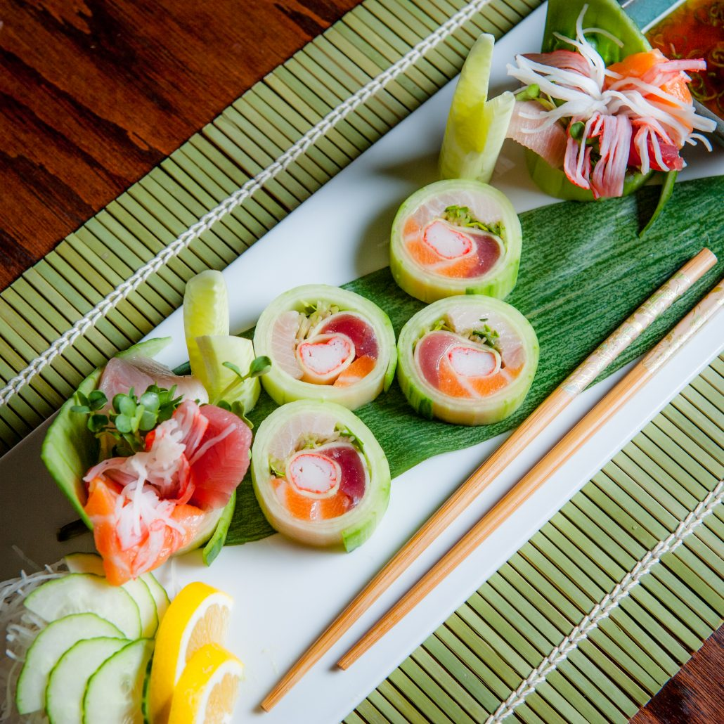 cucumber roll sushi spring green on traditonal green mat