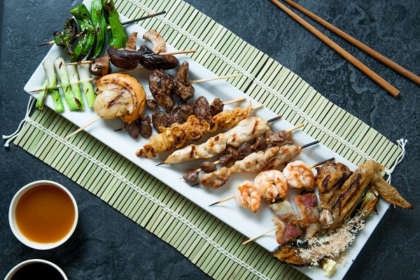 chicken yakitori and other skewered grilled delicacies from Osaka teppan yaki grill displayed on plate ready to eat
