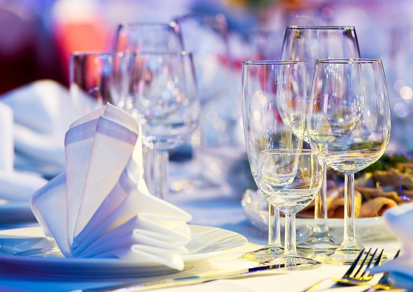 catering table set service with silverware, napkin and glass at restaurant