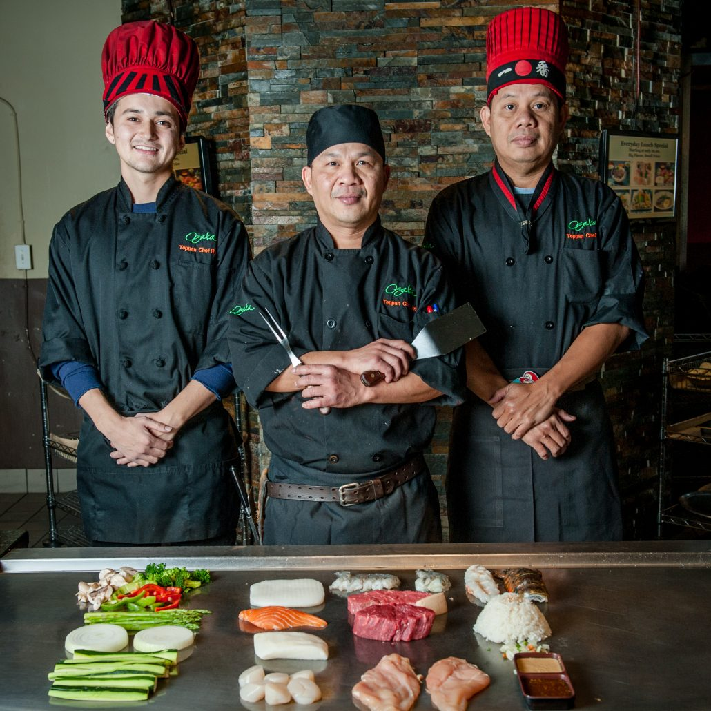 Osaka Japanese Bistro teppanyaki chefs at their grill portrait of three teppan expert chefs