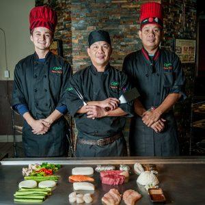 Osaka Japanese Bistro teppanyaki chefs at their grill portrait of three teppan expert chefs